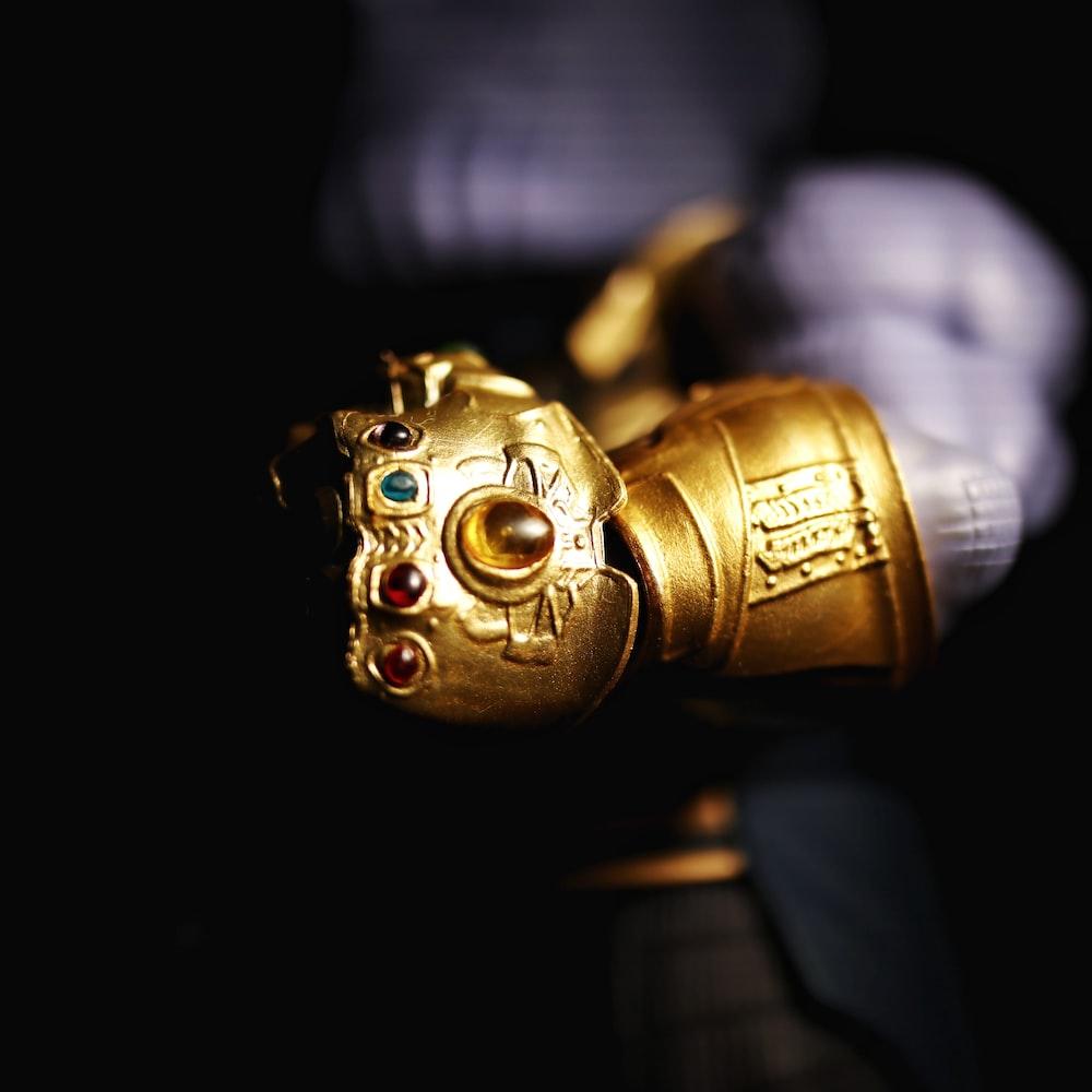 gold robot in black suit