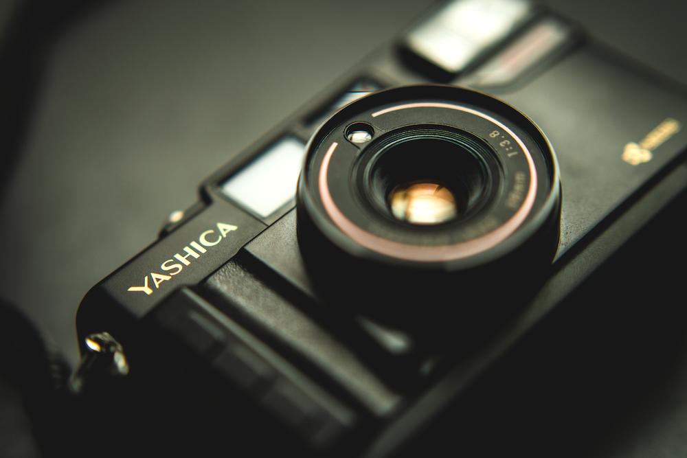 black nikon camera on white table