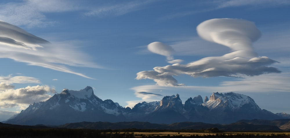 white clouds over mountains during daytime