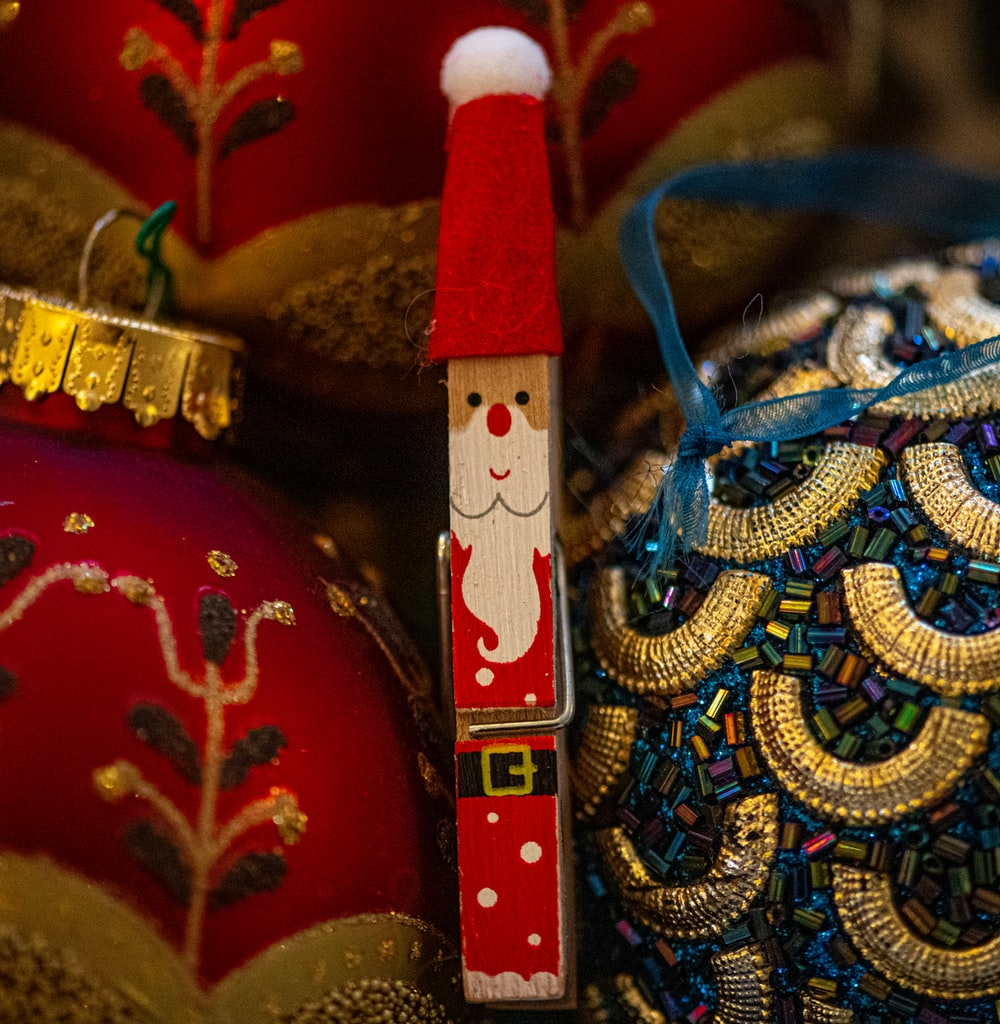 red and gold colored christmas baubles