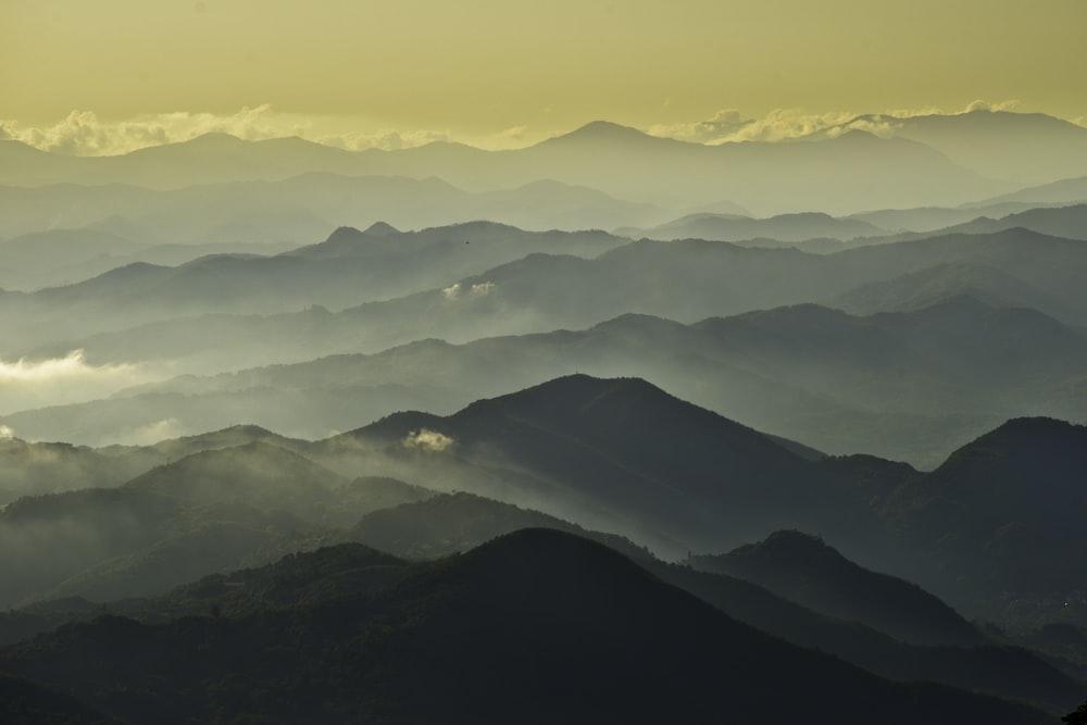 black mountains under white sky during daytime