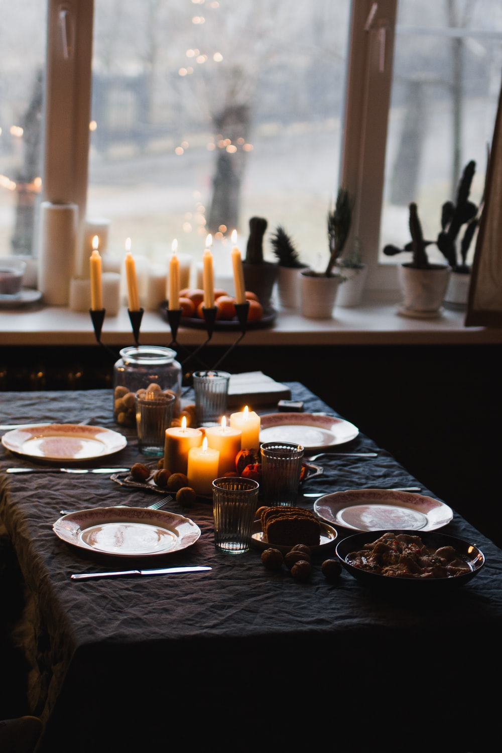 lighted candles on round table