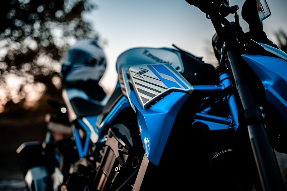 blue and black motorcycle during daytime