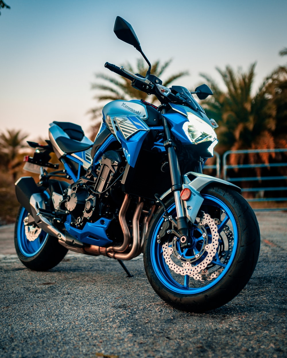 blue and black sports bike on road during daytime