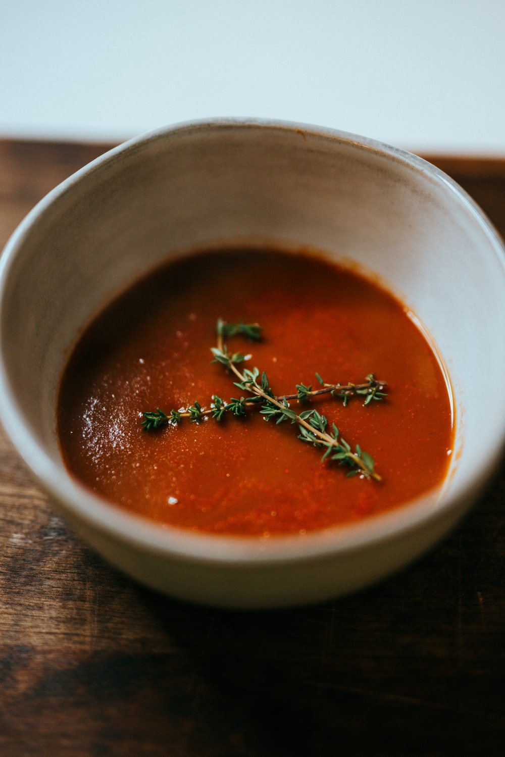 red soup in stainless steel bowl
