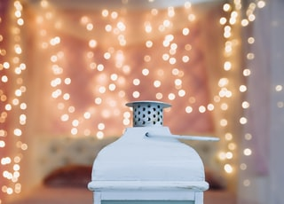 white and black floral candle lantern