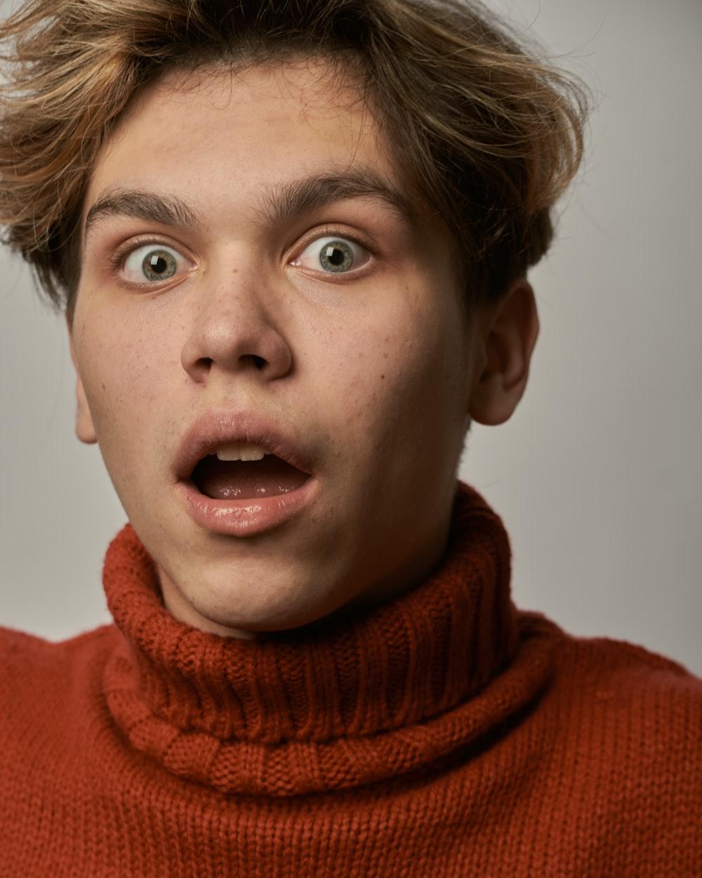 boy in red turtleneck sweater