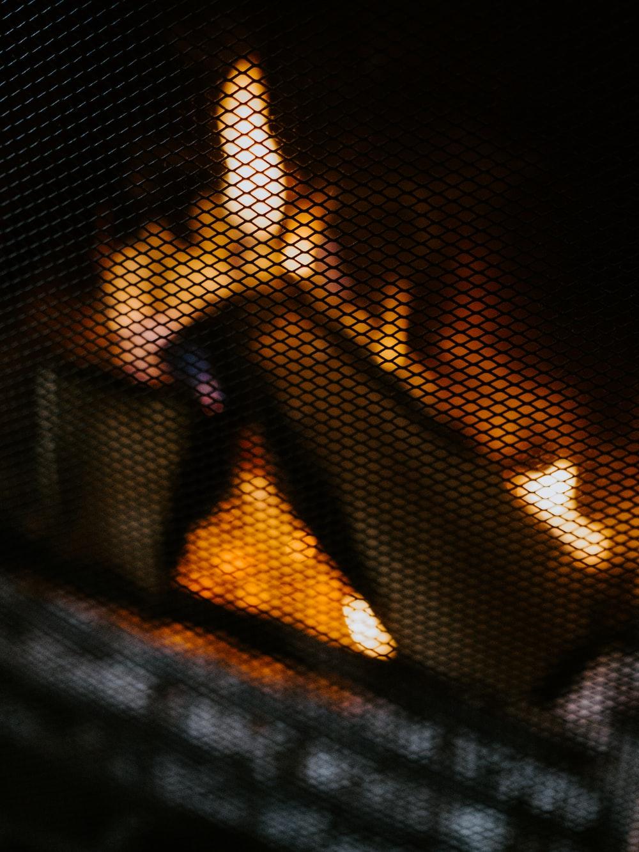brown wood in black metal fireplace