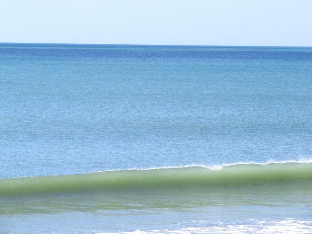 green sea waves during daytime