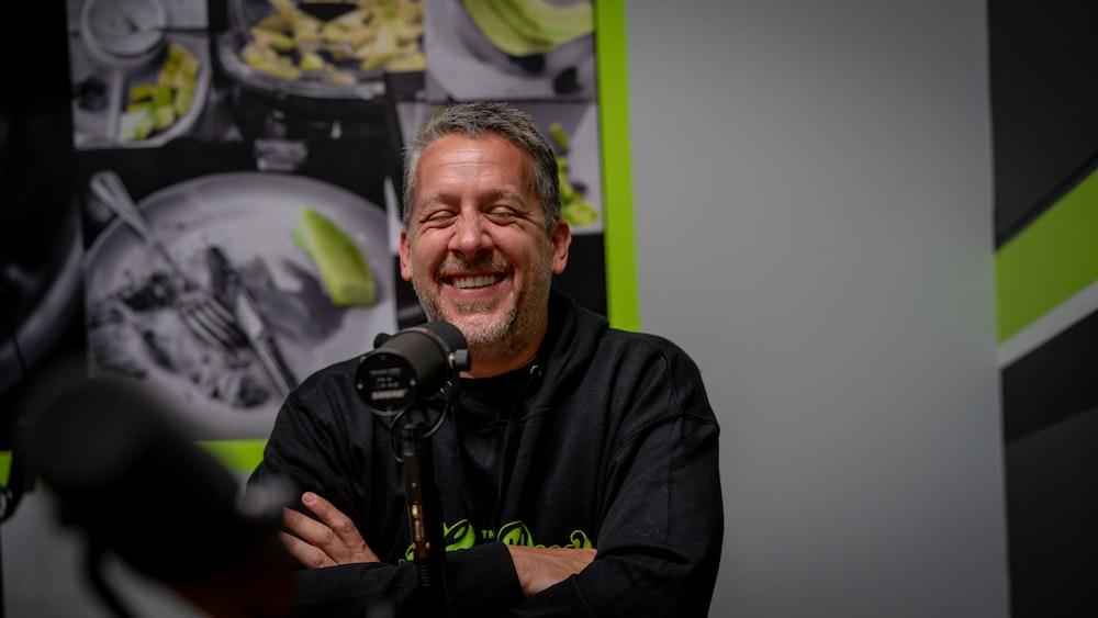 man in black long sleeve shirt holding microphone