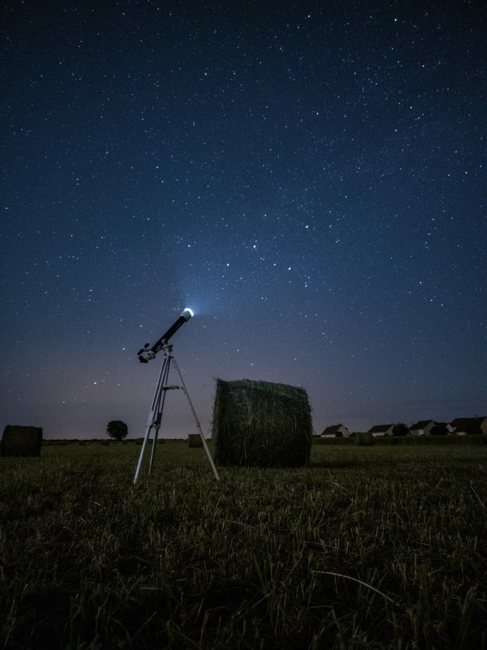 white and black satellite dish on brown field during night time