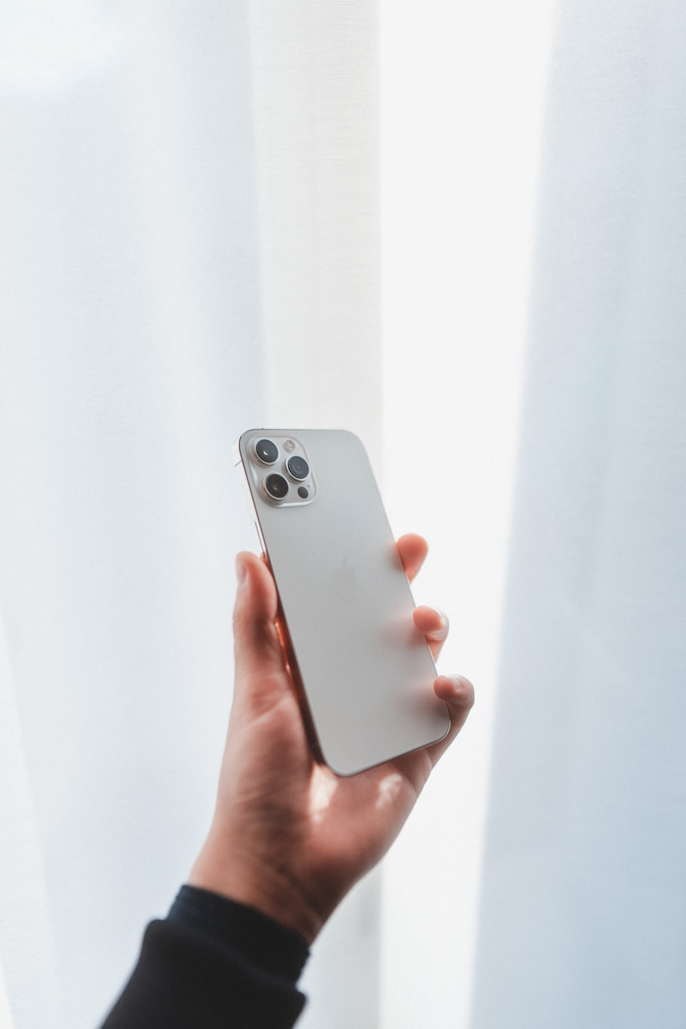 person holding silver iphone 6