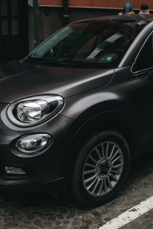 black car with silver 5 spoke wheel