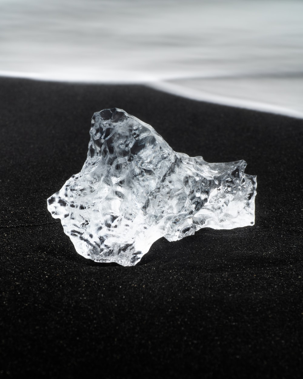 white and brown stone on white sand