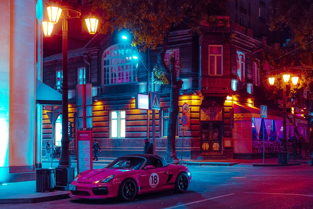 red porsche 911 on road during nighttime