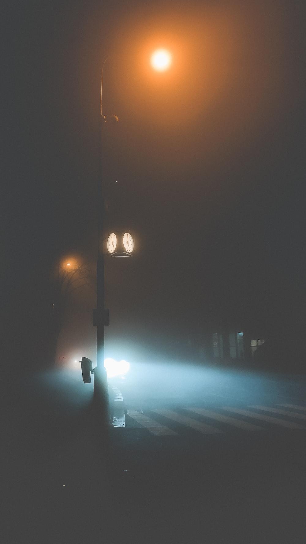black street light turned on during night time