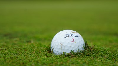 white golf ball on green grass field during daytime masters golf tournament zoom background