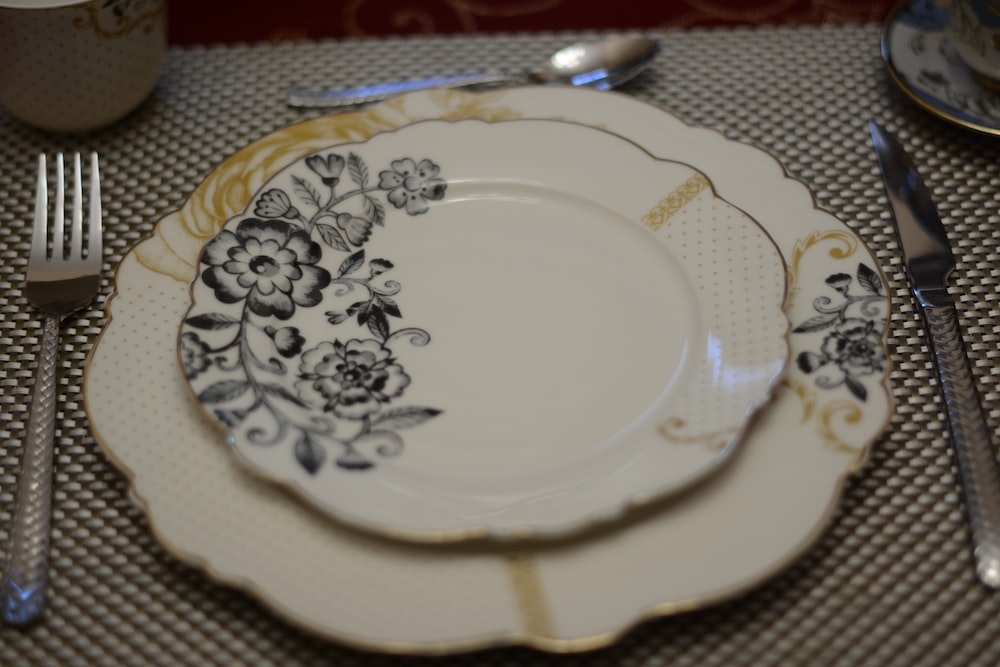 white and black floral ceramic plate