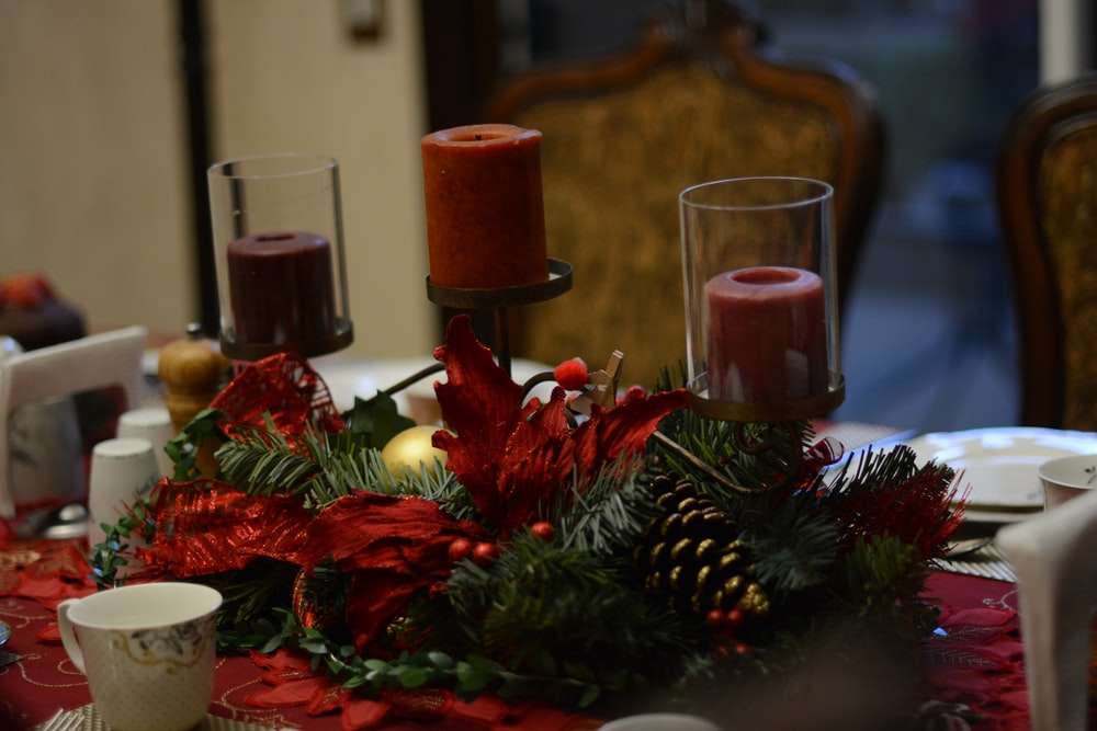 red candles on green pine tree