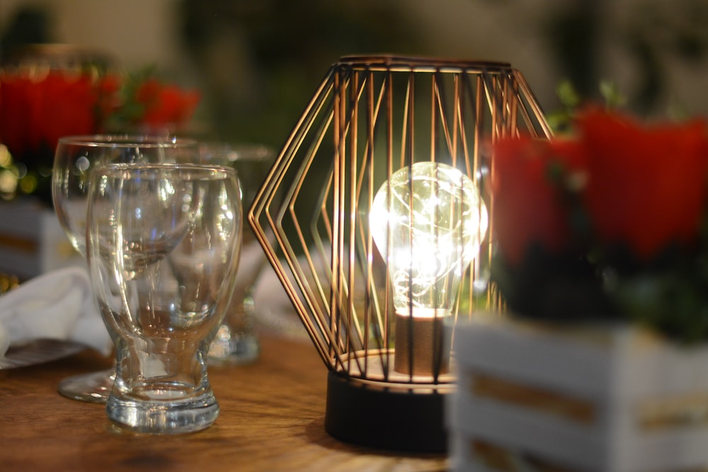 clear glass candle holder on brown wooden table