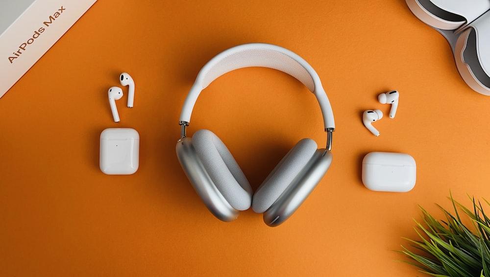 white and gray wireless headphones