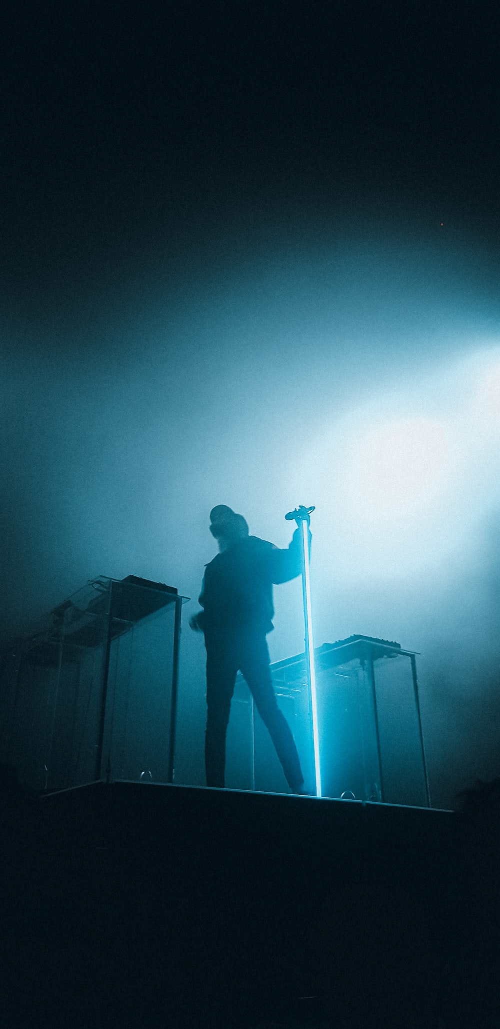 man in black jacket standing on stage