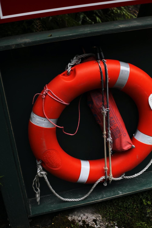 orange and white inflatable life buoy