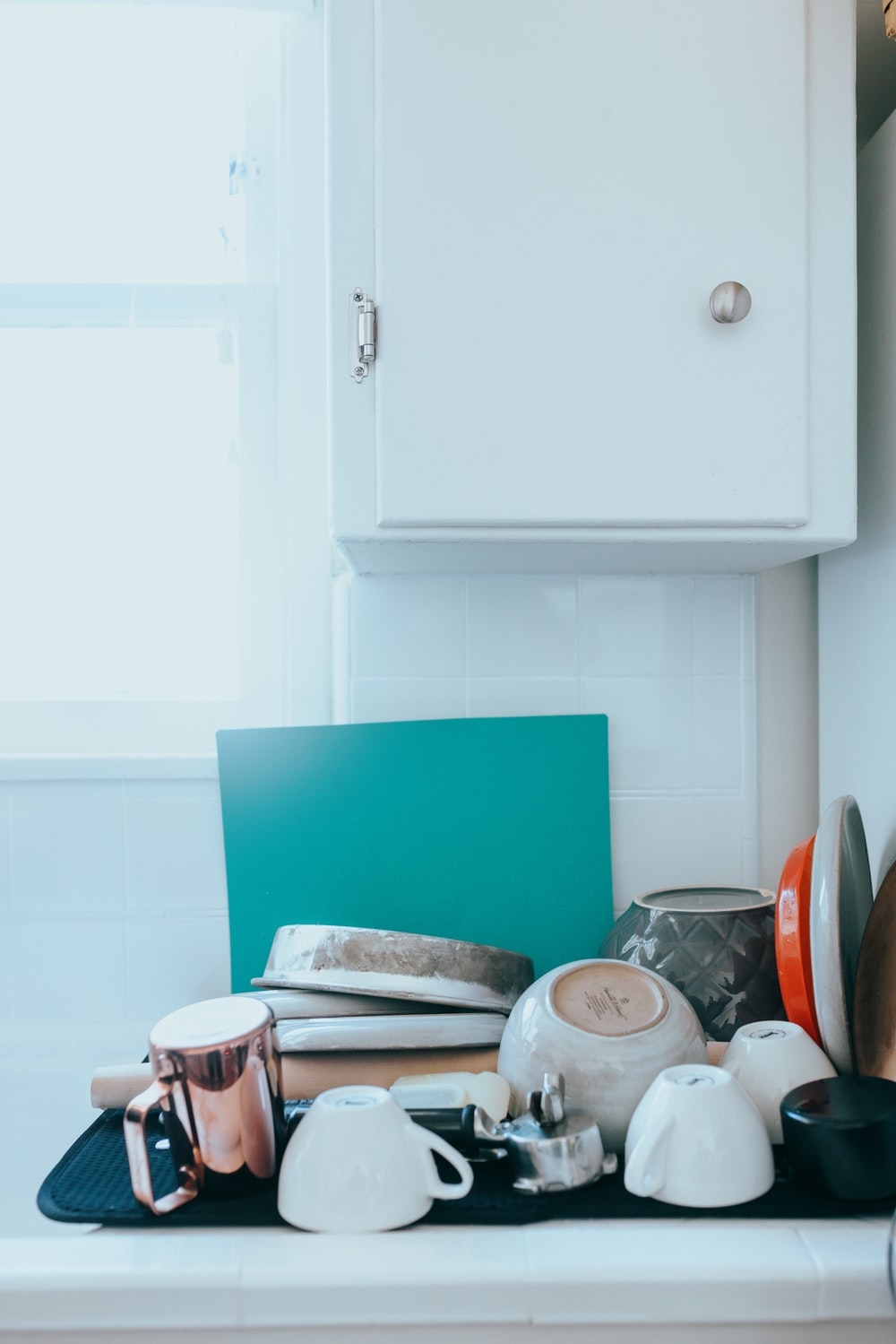 white wooden kitchen cabinet over white ceramic plate