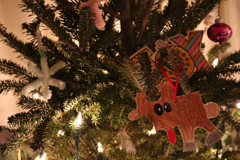 red and brown wooden angel ornament