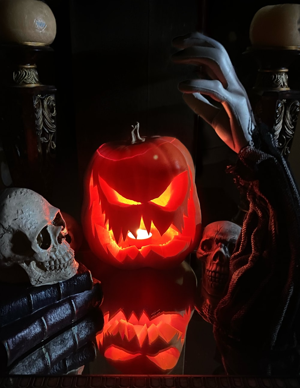 jack o lantern on black textile