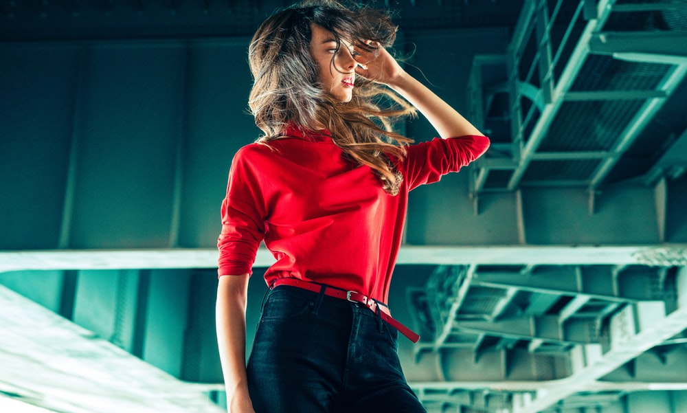 woman in red long sleeve shirt and blue denim jeans