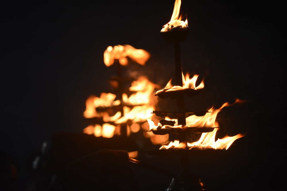 brown stick with fire during night time
