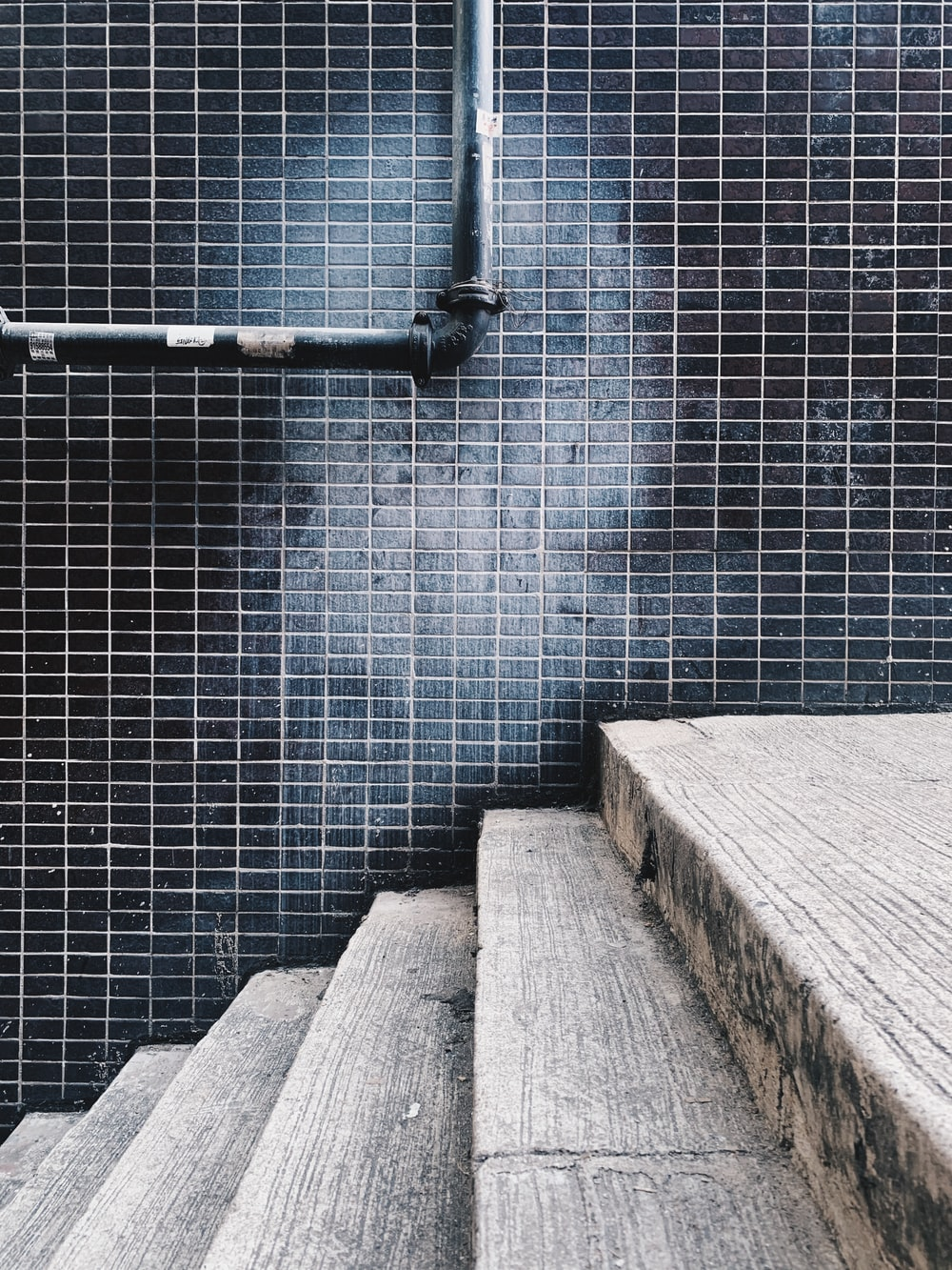 grey concrete stairs with grey metal railings