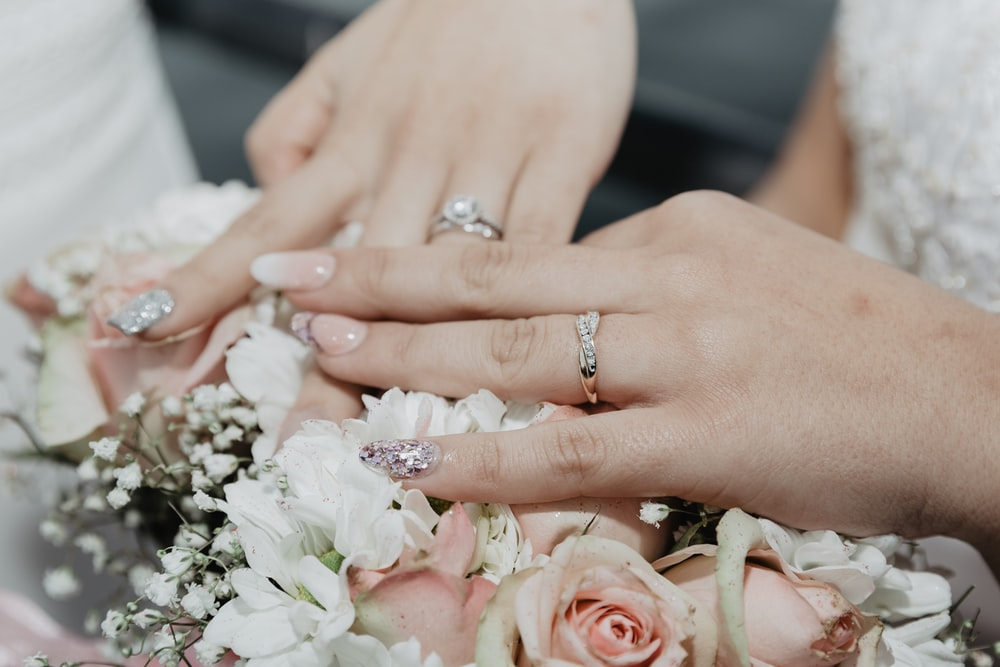 woman in white wedding dress wearing silver diamond ring