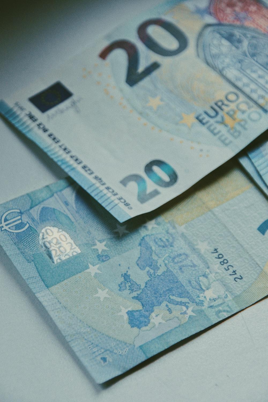 20 euro bill on white paper