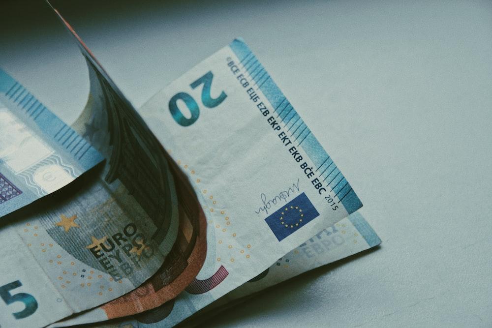 5 euro bill on white table