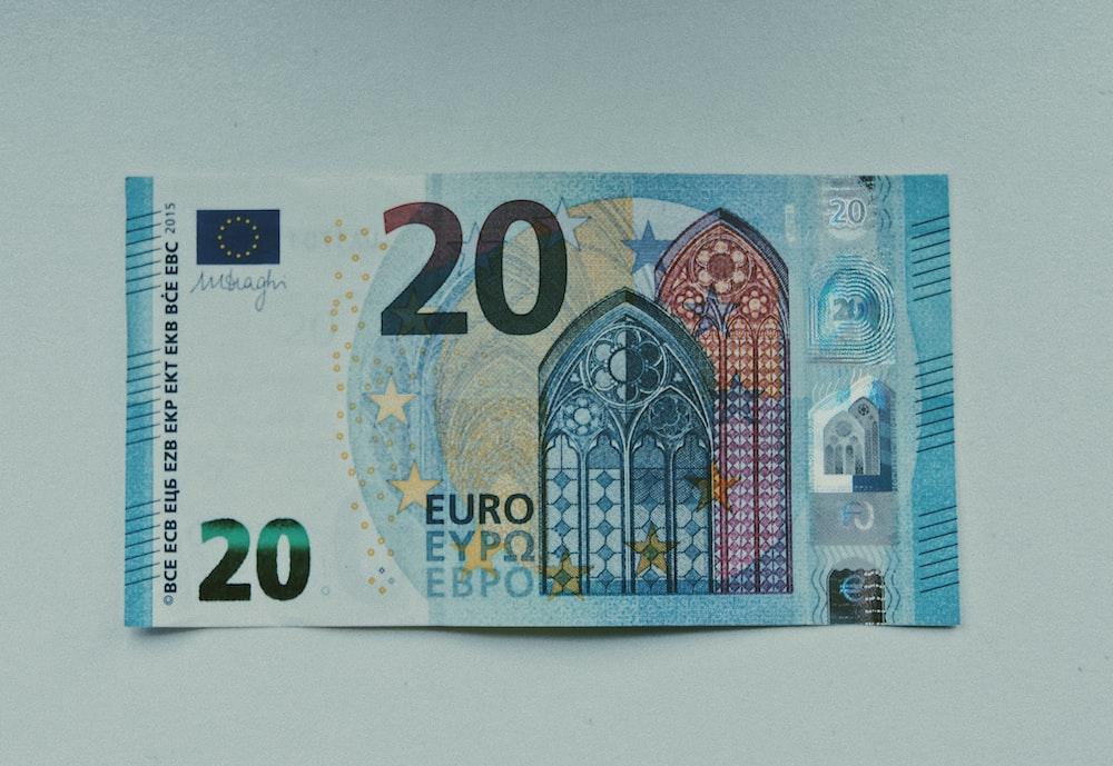 20 euro bill on white table