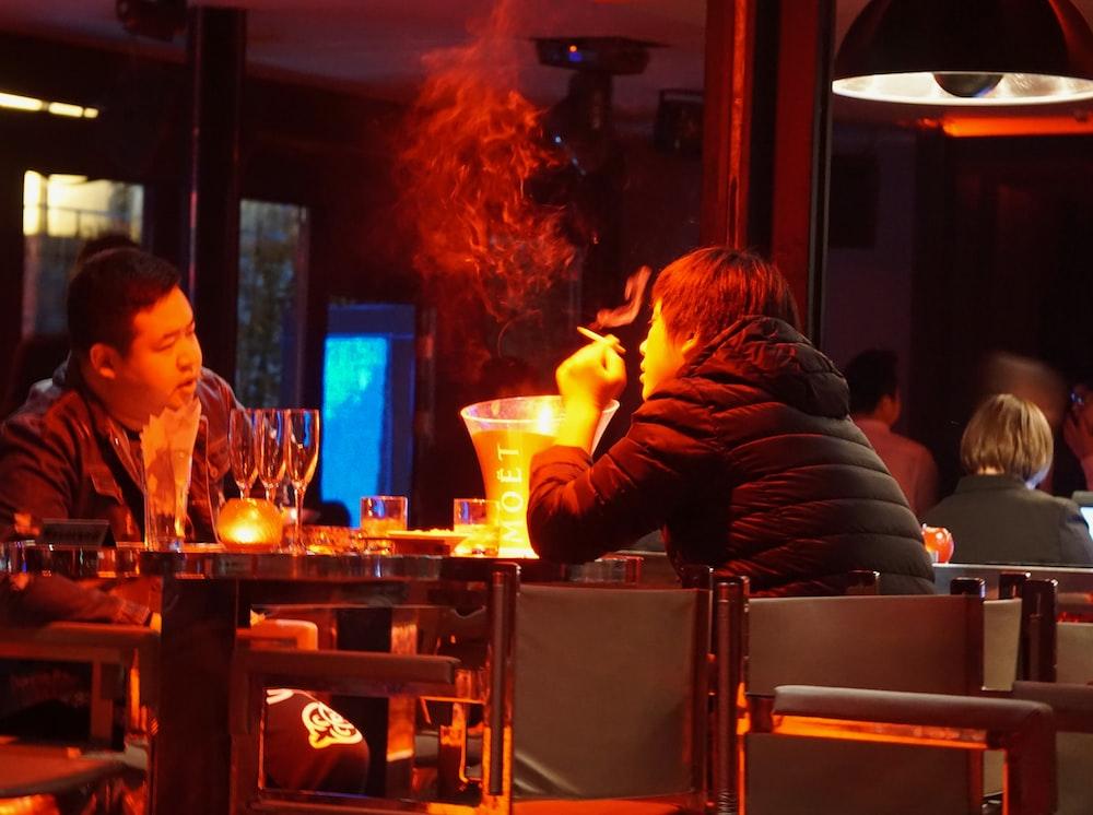 man in black long sleeve shirt smoking