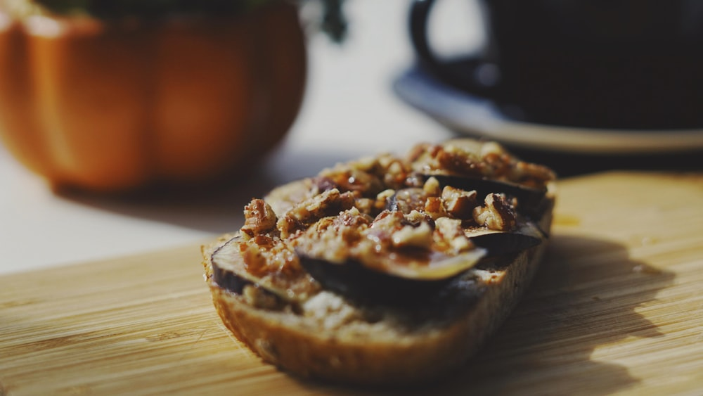 bread with chocolate and peanut butter on brown wooden table