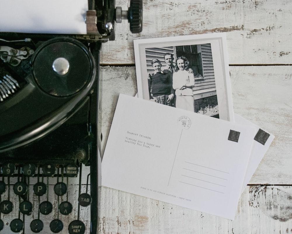 white printer paper on black and white typewriter