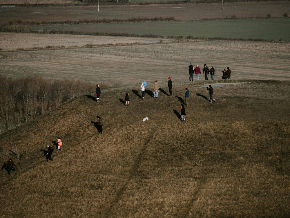 people on brown grass field during daytime