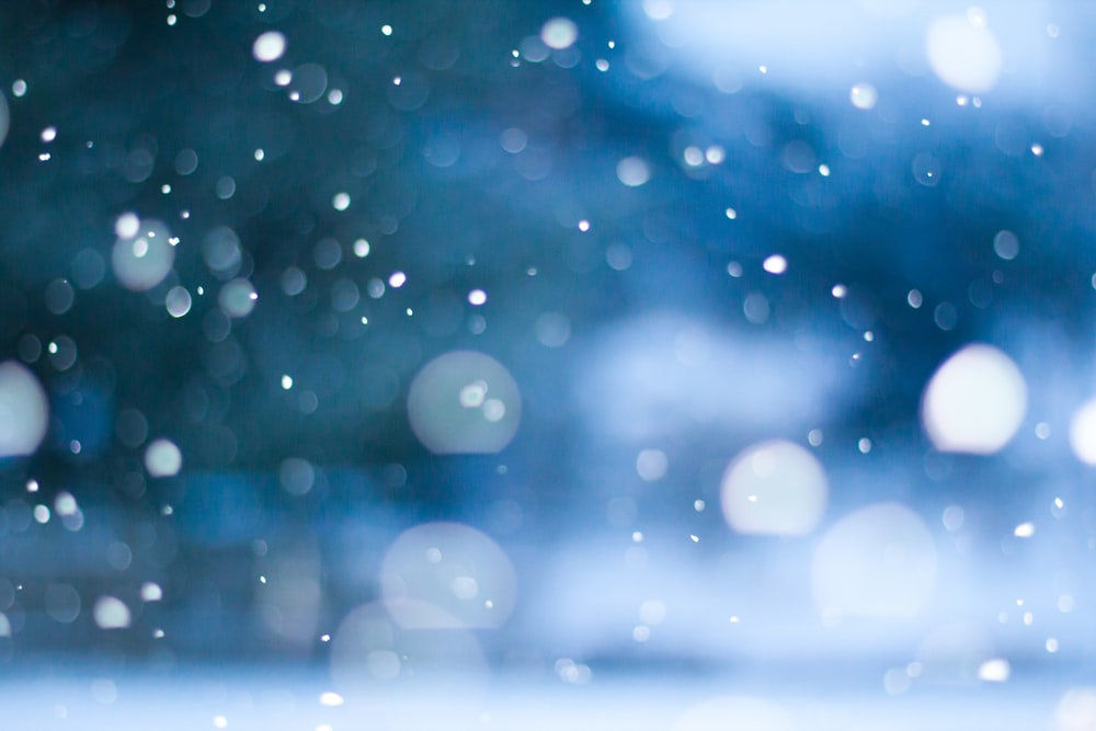 white and blue bokeh lights