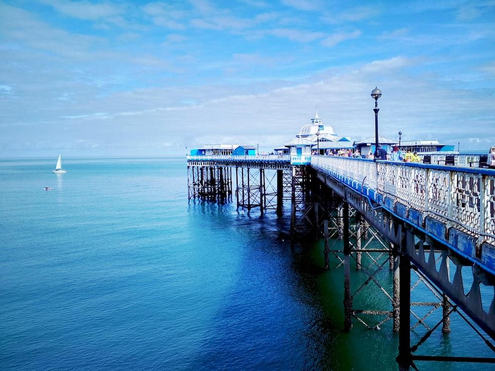 black wooden dock on blue sea under blue sky during daytime
