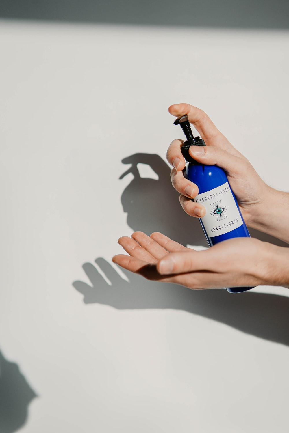 person holding blue and white bottle