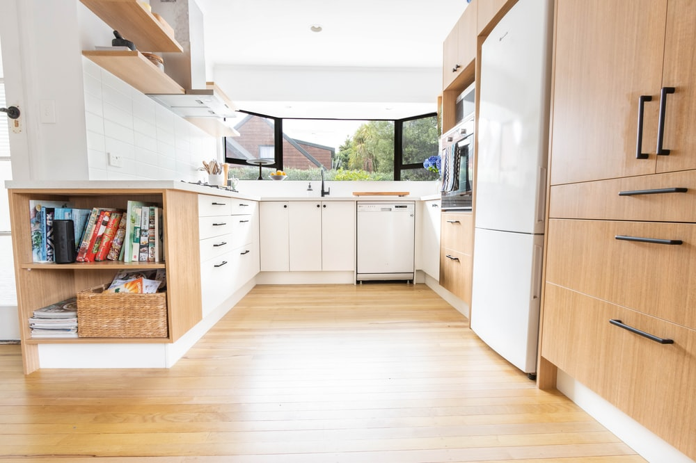 white dishwasher beside brown wooden kitchen cabinet