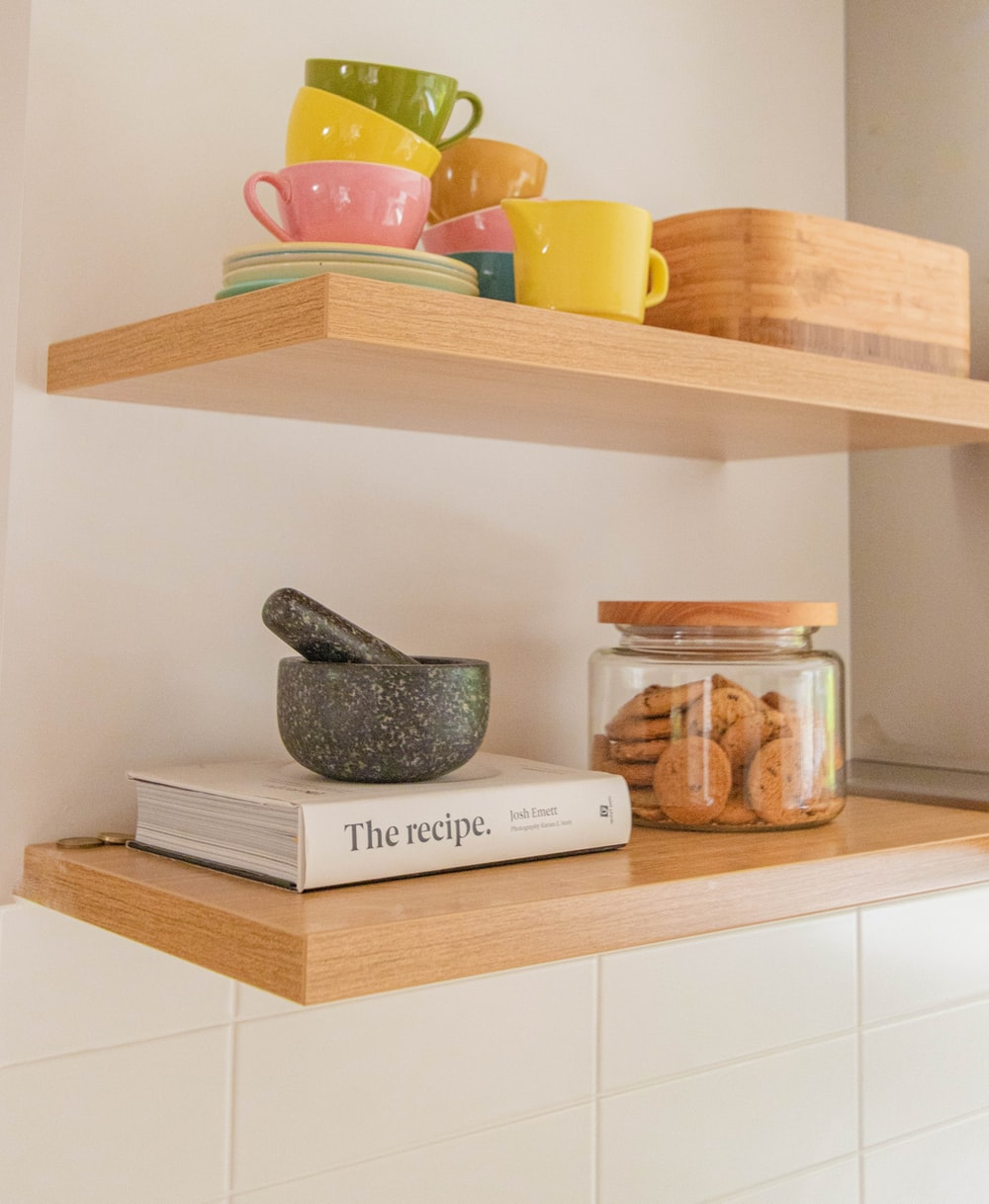 brown wooden shelf with assorted items