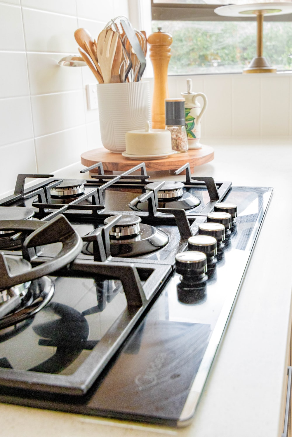 black and white chess pieces on black and silver gas stove