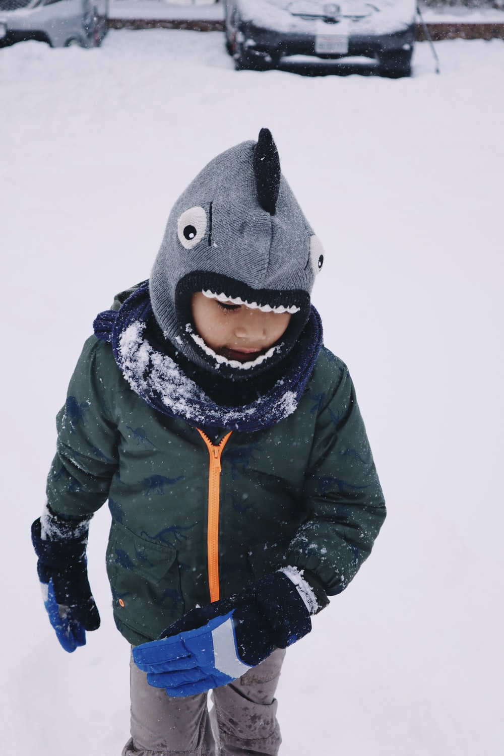 person in black winter coat and gray knit cap