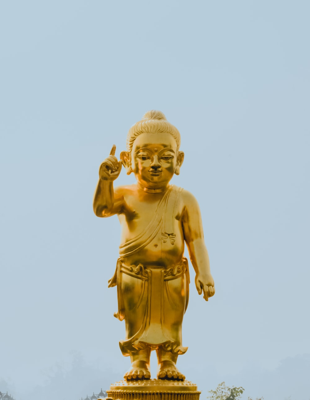 gold statue of a man