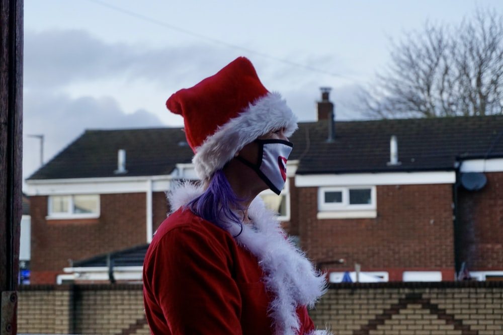 woman in red santa hat and red coat